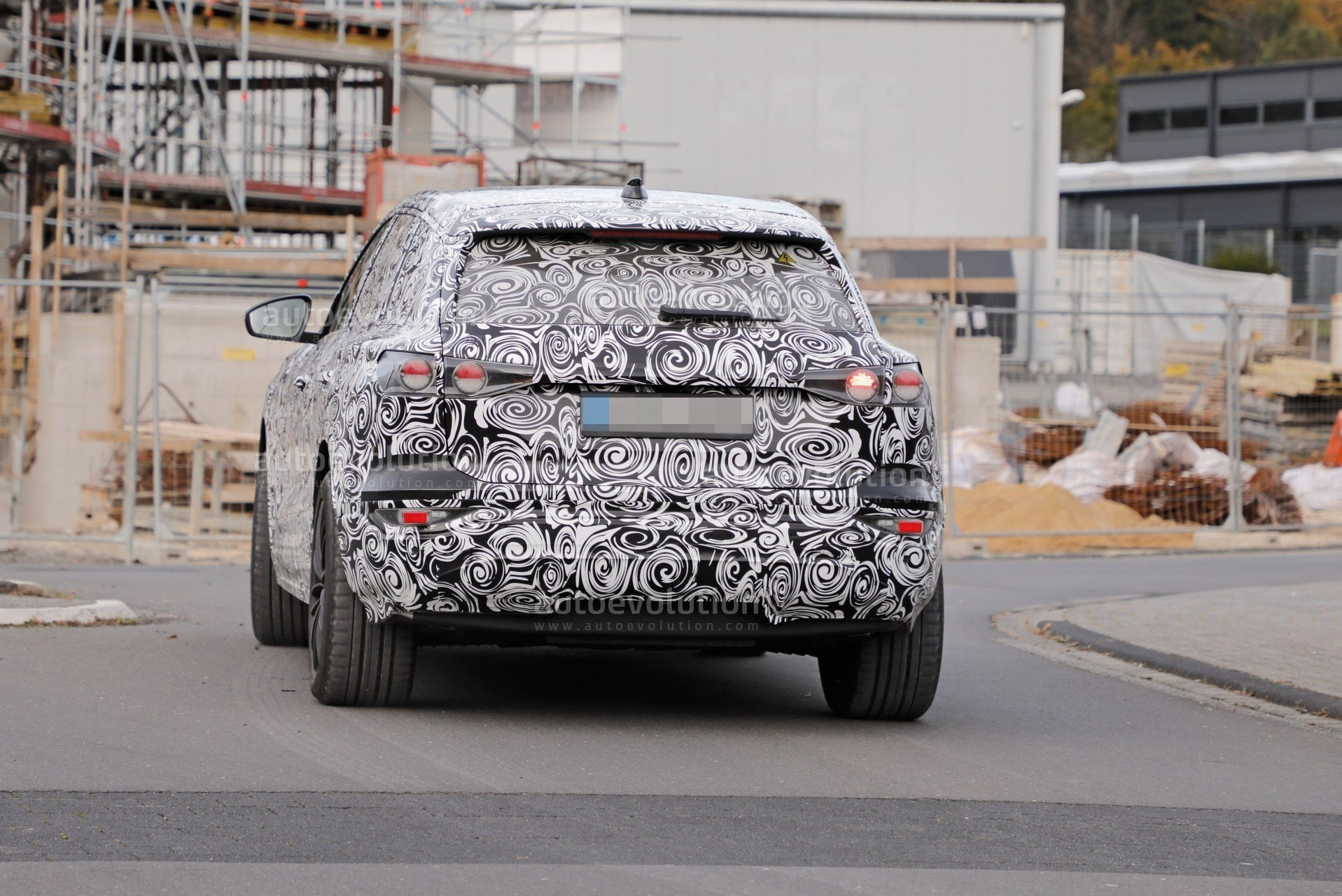 2023-audi-q6-e-tron-prototype-spied-wearing-full-camouflage-is-fully-electric_12.jpg